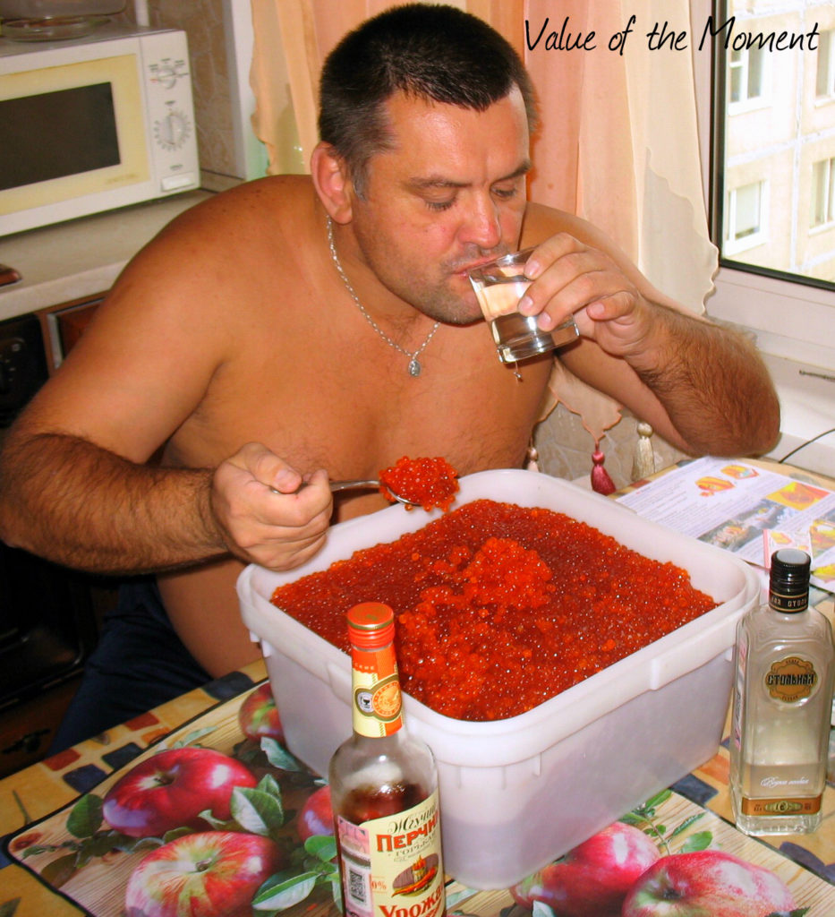 Man drinks vodka and eats caviar from the bowl, Kamchatka, Russia